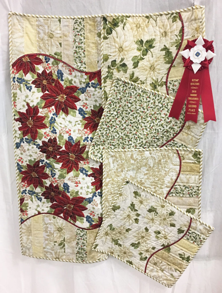 "1004 ""Celebrating Christmas Table Runner and Placemats"" by Ann Trujillo, 2nd Place Miscellaneous Category, 2018 Kitsap Quilt Show"