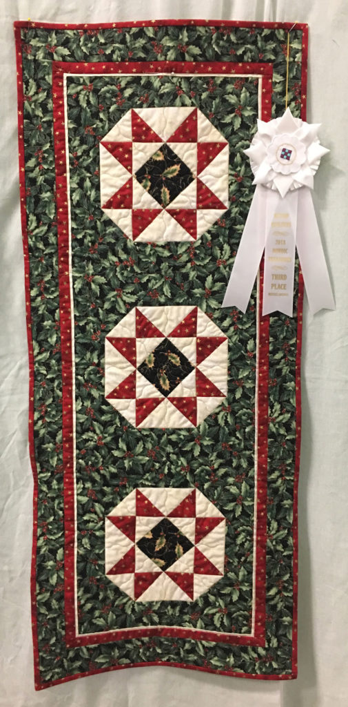 "1011 ""Christmas Table Runner"" by Maggie Ball, 3rd Place Miscellaneous Category, 2018 Kitsap Quilt Show"