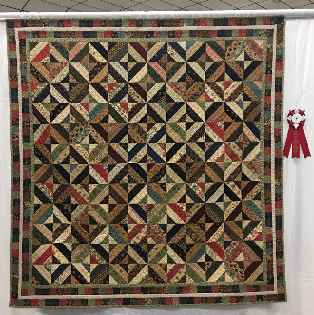 "312 ""Strip Magic"" by Debi Snyder, 2nd Place Med/Large Individual Quilt, 2018 Kitsap Quilt Show"