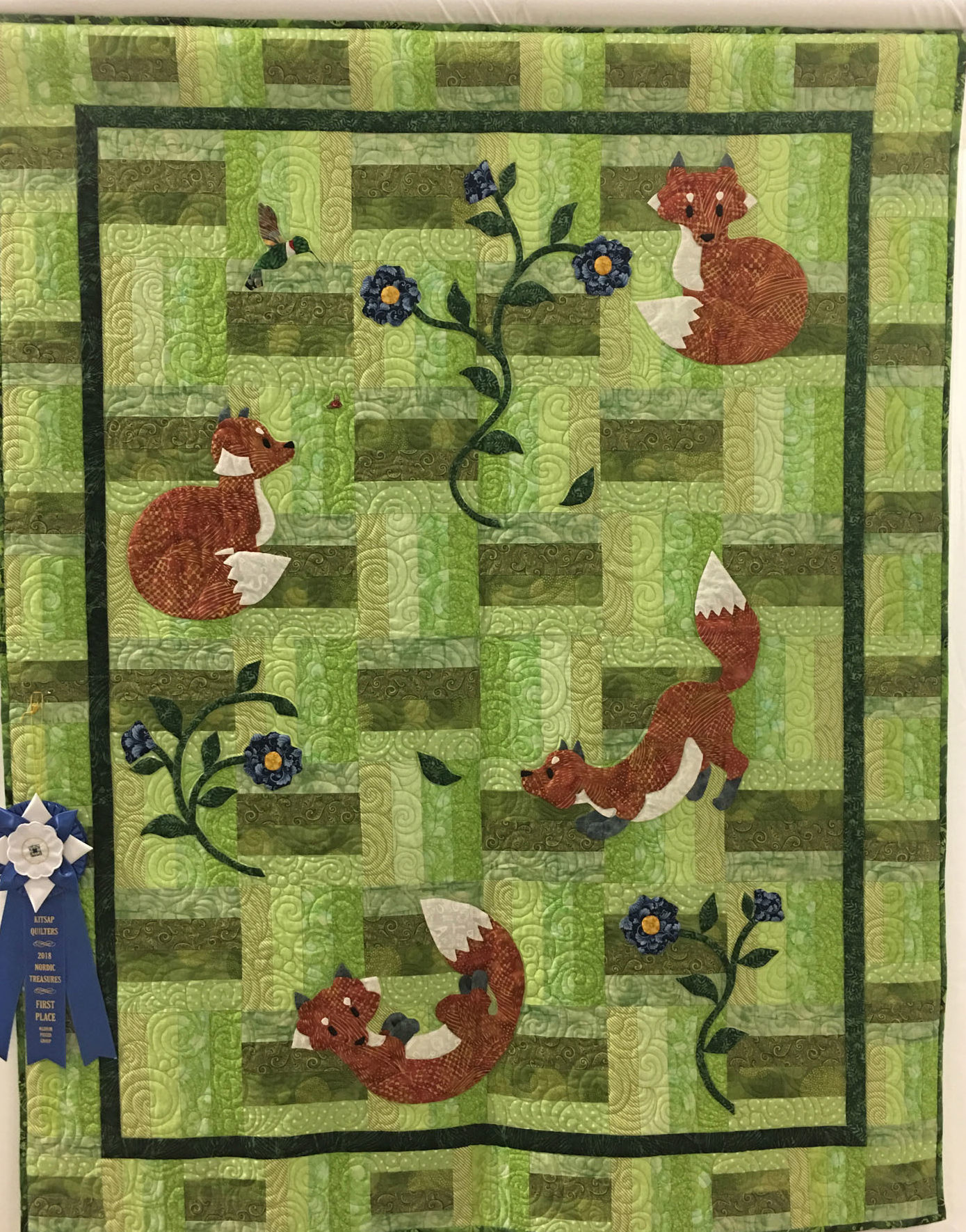 "614 ""Quilt for Kaci"" made by Sharon Broom, quilted by Rainy Day Quilts, 1st place Medium Group Quilt, 2018 Kitsap Quilt Show"